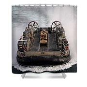 A Landing Craft Air Cushion Transits Shower Curtain