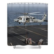 A Mh-60s Knighthawk Conducts A Vertical Shower Curtain