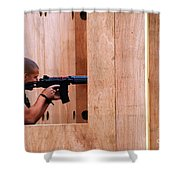 A Belgian Soldier Trying Out A Shooting Shower Curtain