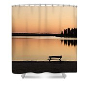 A Bench Silhouetted At Sunset Near The Shower Curtain