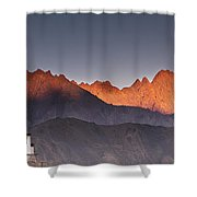 A Building On A Rock Ledge With Shower Curtain