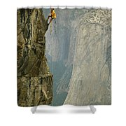 A Climber Makes His Way Up A Rock Face Shower Curtain