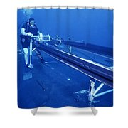 A Crewman Cranks Out The Dry Deck Shower Curtain by Michael Wood