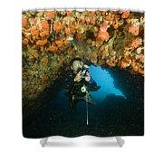 A Diver Explores A Cavern With Orange Shower Curtain