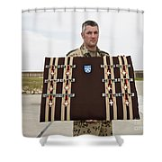 A German Soldier Holds A Display Shower Curtain