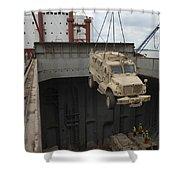 A Harbor Crane Lifts A Mine-resistant Shower Curtain