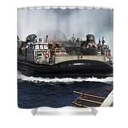 A Landing Craft Air Cushion Transits Shower Curtain