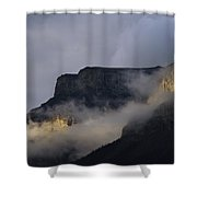 A Mountain Peaks Through The Clouds Shower Curtain