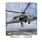 A Naval Aircrewman Is Hoisted Into An Shower Curtain