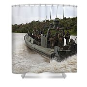 A Navy Riverine Patrol Boat Conducts Shower Curtain