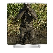 A Participant Wipes Mud From His Face Shower Curtain