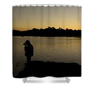 A Photographer At Work During Sunset Over A Lake Shower Curtain