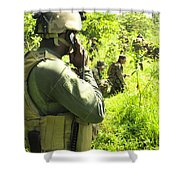 A Riverine Soldier Radios In Mock Shower Curtain