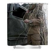 A Scout Observer Applies Camouflage Shower Curtain