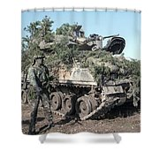 A Soldier Stands Beside A Camouflaged Shower Curtain