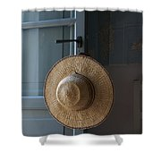 A Sun Hat Hangs On The Door Of A Tuscan Shower Curtain