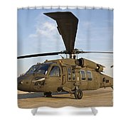 A Uh-60 Black Hawk Parked At A Military Shower Curtain