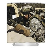 A U.s. Army Soldier Pulls Security Shower Curtain