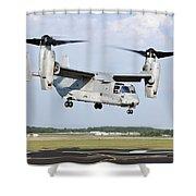 A U.s. Marine Corps Mv-22 Osprey Lifts Shower Curtain