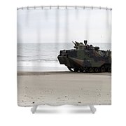 A U.s. Marine Guides An Amphibious Shower Curtain