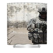 A U.s. Soldier Tests A Tactical Shower Curtain
