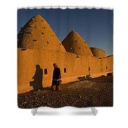 A Woman Walks Past A Sunlit Mud Brick Shower Curtain