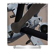 An A-10 Thunderbolt II Receives Fuel Shower Curtain