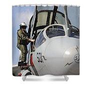 An Airman Makes A Final Look Over An Shower Curtain