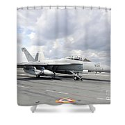 An Ea-18g Growler Takes Off From Uss Shower Curtain