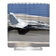 An Fa-18e Super Hornet Lands Aboard Uss Shower Curtain