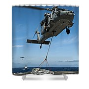 An Mh-60s Sea Hawk Helicopter Lowers Shower Curtain