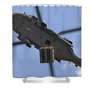 An Mh-60s Seahawk Helicopter Airlifts Shower Curtain