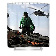 An Mh-60s Seahawk Passes Over Two Shower Curtain