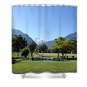 An Open Field In Interlaken With A View Of The Mountains In The Background Shower Curtain