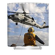 An Sh-60b Sea Hawk Helicopter Releases Shower Curtain