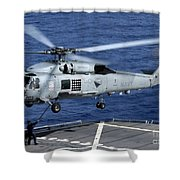 An Sh-60b Seahawk Helicopter Performs Shower Curtain