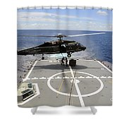 An Sh-60f Sea Hawk Helicopter Lowers Shower Curtain