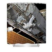 Astronaut Traverses Shower Curtain