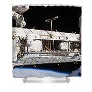 Astronauts Continue Maintenance Shower Curtain