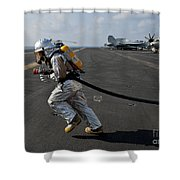 Aviation Boatswain's Mate Carries Shower Curtain