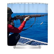 Aviation Ordnanceman Fires An M-14 Shower Curtain