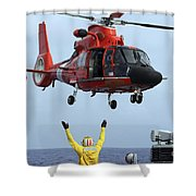 Boatswain Mate Directs A Hh-65a Dolphin Shower Curtain by Stocktrek Images