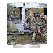 British Soldiers Help A Simulated Shower Curtain
