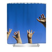 Childrens Hands Reach Toward The Blue Shower Curtain