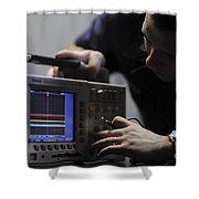 Electronics Technician Troubleshoots An Shower Curtain