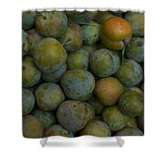 Green Plums Fill A Bin Outside A Local Shower Curtain