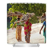 Group Of Women Carrying Firewood Near Shower Curtain