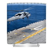 N Mh-60s Sea Hawk Helicopter Lifts Shower Curtain