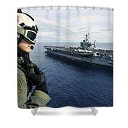 Naval Air Crewman Conducts A Visual Shower Curtain