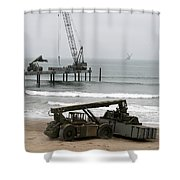 Navy Seabees Dismantling An Elevated Shower Curtain